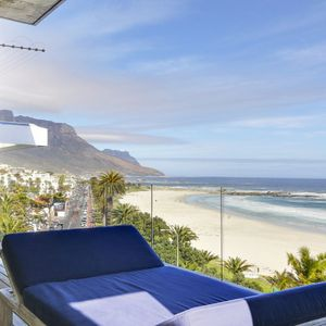 Recliner lying bed on balcony; VIEWS PENTHOUSE - Camps Bay