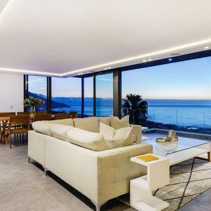 Open Plan living area; SKYLINE VILLA - Camps Bay