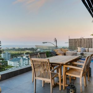 Outdoor dining and view; 129 OCEAN VIEW PENTHOUSE - Green Point