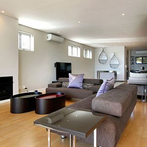 Living & TV area; MEDBURN PENTHOUSE - Camps Bay
