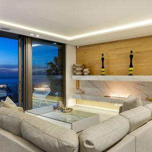 Living room; SKYLINE VILLA - Camps Bay