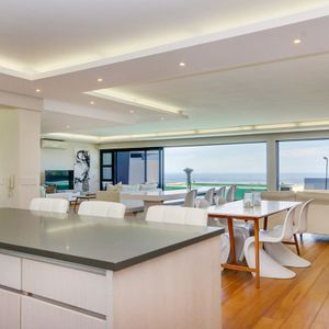 Kitchen to lounge; TOUCH OF WHITE - Camps Bay