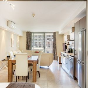 Dining table and kitchen; 403 CANAL QUAYS - Foreshore