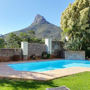 Pool with mountain view; 100 ON GENEVA - Camps Bay