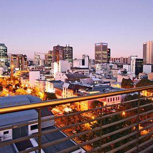 View over city at dusk; CITY VIEW LOFT - CBD