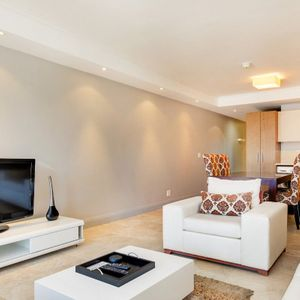 TV and sofa; 506 CANAL QUAYS - Foreshore