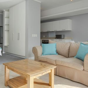 Living area and kitchen; 303 HARBOUR BRIDGE - Foreshore