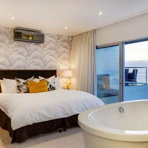 Master en-suite bedroom; MOUNTAIN VIEW VILLA - Camps Bay