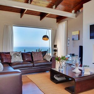 Living area & fire place; OUDERKRAAL PLACE - Camps Bay