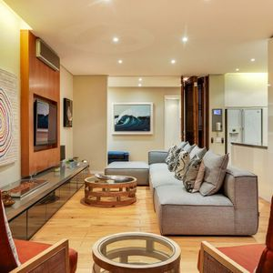 Living area and TV; 129 OCEAN VIEW PENTHOUSE - Green Point