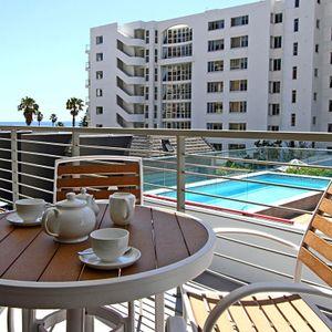 Outdoor seating & pool; FAIRMONT 201 - Sea Point