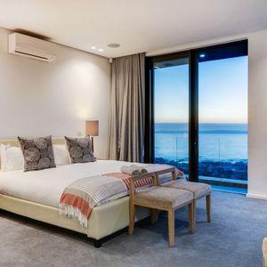 Master bedroom & Views; SKYLINE VILLA - Camps Bay
