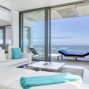 Living area with ocean view; VIEWS PENTHOUSE - Camps Bay