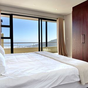 Second bedroom & Views; MEDBURN PENTHOUSE - Camps Bay