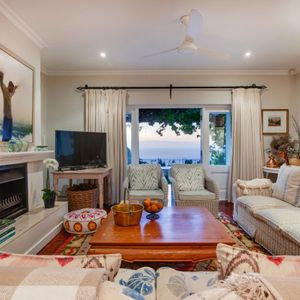 Living room with fireplace; OVERGLEN - Camps Bay