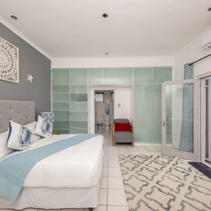 Master bedroom; BLUE SHORE VILLA - Camps Bay