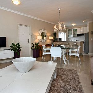 Living & dining area; THE FLEUR - Camps Bay