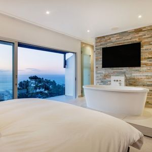 Master bedroom with views; MOUNTAIN VIEW VILLA - Camps Bay
