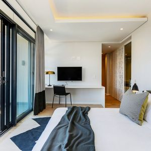 Master bedroom and TV; PENTHOUSE ON POINT - Green Point