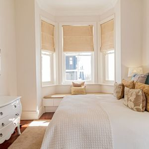 Master bedroom with bay window view; SELBOURNE - Sea Point