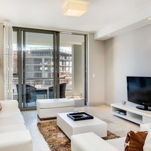 Living area and TV; 506 CANAL QUAYS - Foreshore