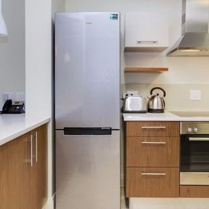 Kitchen with fridge and stove; 507 CANAL QUAYS - Foreshore