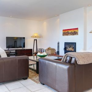 Living area and TV; CAMPS LUXURY - Camps Bay