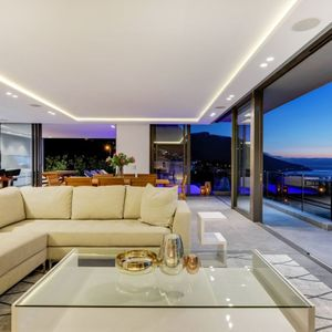Living room with views; SKYLINE VILLA - Camps Bay