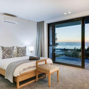 Second bedroom & views; SKYLINE VILLA - Camps Bay