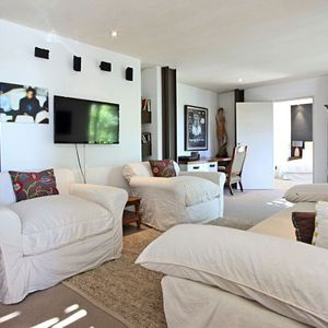 Living area & TV; GENEVA LOW - Camps Bay