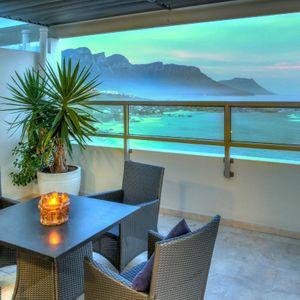 Balcony with sea & mountain views; SKYFALL - Clifton