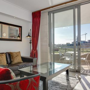 Living room and balcony; 205 CANAL QUAYS - Foreshore