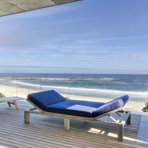 Balcony with recliner lying bed & ocean view; VIEWS PENTHOUSE - Camps Bay