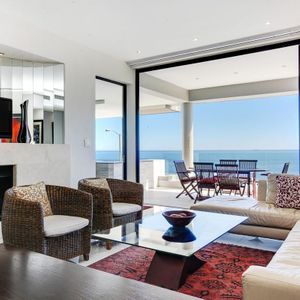 Living area & TV & Fireplace; BALI SUITE - Camps Bay