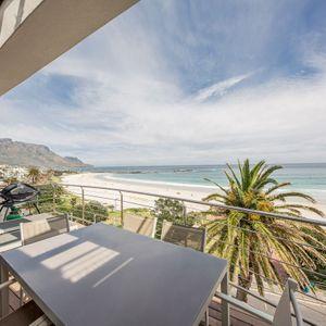 Balcony seating; SEASONS B - Camps Bay