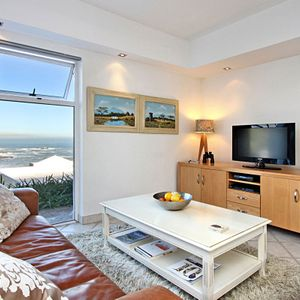 Living area & TV; TERRACE SUITE - Camps Bay